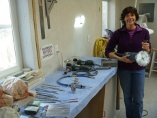 Ellen Woodbury displays some of the tools she uses to create her stone sculptures.