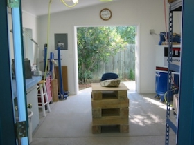 Ellen Woodbury Creative Process: Studio, carving stand through the front door, looking back through the loading doors.