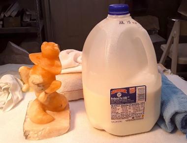 Newt sculpture and gallon of milk